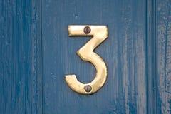 dörrnummer för 3 blue Arkivfoto