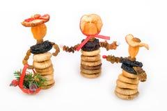 Dörrobst-Weihnachtspuppen Stockfotos