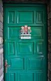dörrteckenvälkomnande Arkivbild
