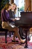Dúo del piano de la madre y de la hija Fotografía de archivo libre de regalías
