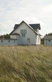 Dünen-Gras mit Häuschen Lizenzfreies Stockfoto