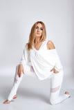 Dünne Zahl des schönen jungen sexy blonden Athleten der Frau perfekten Stockfoto