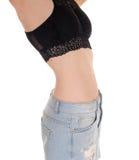 Dünner Magen und Kolben der jungen Frau Stockfoto