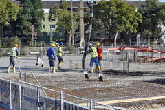 Düsseldorf, Germany - Construction Boom. DÜSSELDORF, GERMANY - OCTOBER 5: A Group of construction workers during the concreting of the ceiling slab in Dü Royalty Free Stock Photo