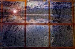 Düsterer Sonnenuntergang mit Regen Lizenzfreies Stockfoto