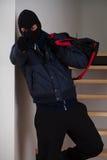 Dążący rabuś z torbą Zdjęcia Royalty Free