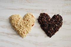 Dłudzy zbożowi ryż, brown ryż, zdrowy pojęcie Obraz Royalty Free
