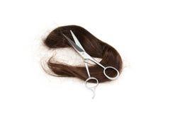 Długie włosy i cążki na białym tle Obrazy Royalty Free