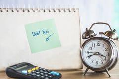 Długu pojęcia bezpłatny tło z zegarem i kalkulatorem na biurku zdjęcie royalty free