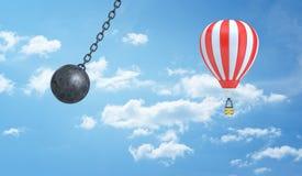 3d一个巨型击毁的球的翻译在被覆盖的天空背景的一个镶边热空气气球附近危险地摇摆 免版税库存图片
