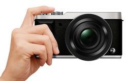 3D例证互换性的透镜Mirrorless照相机在手中 免版税图库摄影