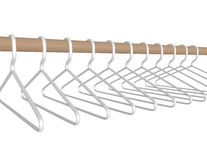 3d回报垂悬在标尺的塑料挂衣架 库存图片