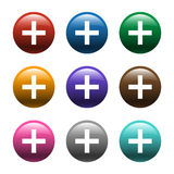 3D圆的五颜六色的加号 库存照片
