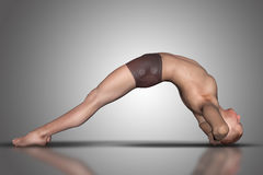 3D在瑜伽姿势的男性图 库存图片