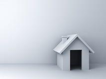 3d在白色墙壁背景的简单的房子模型与空白 免版税库存照片