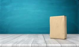 3d在蓝色背景的一张木书桌垂直安置的一个唯一闭合的水泥袋子的翻译 库存图片