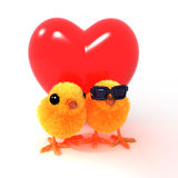 3d对在红色心脏前面的复活节小鸡 库存照片