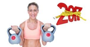 3D微笑的女性crossfitter举的kettlebells的综合图象 免版税库存图片