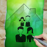 画3d有家庭象的手房子 免版税库存照片