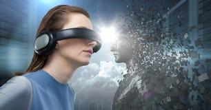 3D染黑中间面对VR的男性AI妇女与火光反对服务器 免版税库存图片