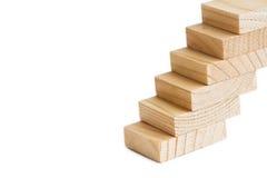 3d概念例证木台阶的成功 楼梯梯子 上升减速火箭的样式的楼梯  软的焦点白色背景 复制空间 图库摄影