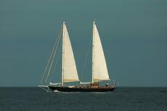 3d横向帆船日落 库存照片