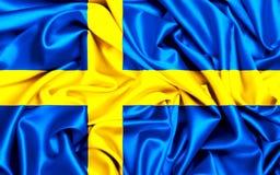 3d瑞典的挥动的旗子在一个大风天 库存图片