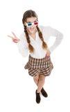 戴3d眼镜的书呆子女孩v胜利的 免版税库存图片