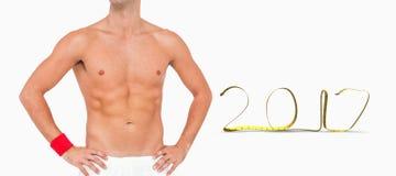 3D站立在白色背景的男性运动员的综合图象 免版税库存照片