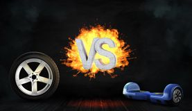 3d翻译火焰状具体信件对在车轮和一蓝色自平衡之间的立场上 库存图片