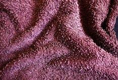 3d背景织品紫色回报 这是显示它和句子的图片描述它 库存照片