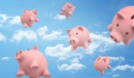 3d自由地飞行在蓝色多云天空背景的翻译许多桃红色存钱罐的 免版税库存照片