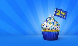3D蓝色杯形蛋糕,在杯形蛋糕附近的黄色条纹翻译  免版税库存照片