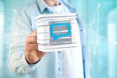 3D представляя голубой символ электронной почты показанный в отрезанном кубе Стоковые Изображения