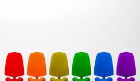 3d翻译 五颜六色的办公室椅子有灰色copyspace背景 免版税库存照片