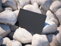 在小卵石的黑名片 3d翻译 库存图片