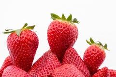 D'abord, deuxième et troisième - La d'isolement de fraises Photographie stock libre de droits