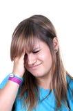 D'adolescent roux avec la migraine Photographie stock