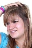 D'adolescent roux avec la migraine Image libre de droits
