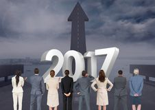 3D 2017 against composite image of business people looking at road leading towards sky Royalty Free Stock Images