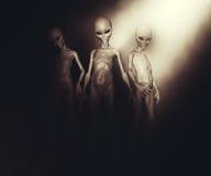 3D Aliens in moody lighting. 3D render of a group of aliens in atmospheric lighting Stock Photo