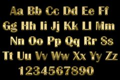3d alphabet in gold letters on a black background. Image of 3d alphabet in gold letters on a black background Stock Images