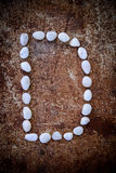 'D' alphabet made form white stone Royalty Free Stock Image