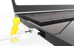 3d amarillean el carácter están a punto de enchufar un cable del usb a un puerto de usb del dispositivo Fotografía de archivo libre de regalías