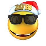 3d amarillean sonrisa del emoticon con el sombrero 2018 de la Navidad Fotos de archivo