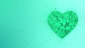 3d animation: Abstract looped animated background: Rotating luminous emerald heart formed pieces and cubes of green spinning stock footage