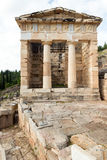 D. The archaeological site of Delphi has been inscribed upon the the World Heritage List of UNESCO. The Athenian treasury Royalty Free Stock Image