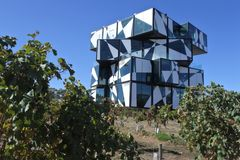 D`Arenberg Cube | McLaren Vale,South Australia. D`Arenberg Cube, a famous five story multi-function building and  tourist attraction set among Mourvedre vines at stock photography
