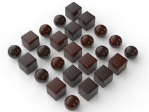 3d assorted chocolate balls and cubes. 3d render of assorted chocolate balls and cubes Royalty Free Stock Image