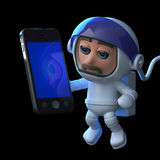3d Astronaut using a tablet smartphone. 3d render of an astronaut floating in space and using a smartphone Royalty Free Stock Images